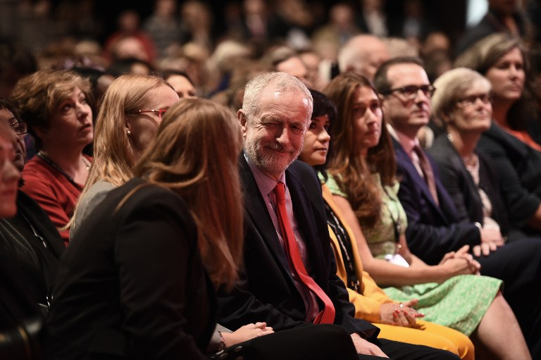 British Labour leader Jeremy Corbyn, center, sits in the audience ahead of the opposition party's leadership announcement, at the Labour Party Leadership Conference in Liverpool on September 24, 2016. (AFP Photo/Oli Scarff)