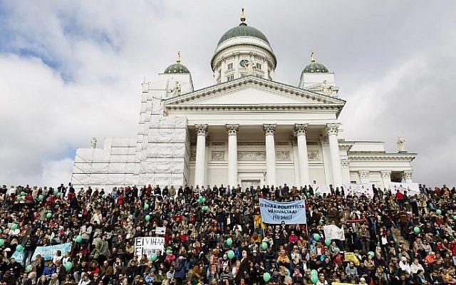 Participants demonstrate against racism and fascism in Helsinki, Finland, on September 24, 2016. AFP/Lehtikuva/Roni Rekomaa)