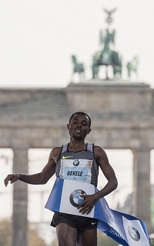 Ethiopian Kenenisa Bekele crosses the finish line to win the 43rd Berlin Marathon in Berlin on September 25, 2016. (AFP PHOTO / John MACDOUGALL)