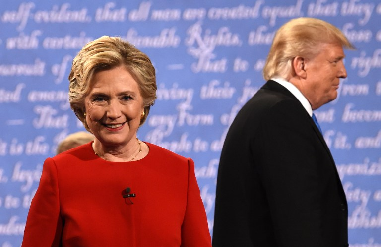 Democratic nominee Hillary Clinton and Republican nominee Donald Trump leave the stage after the first presidential debate at Hofstra University in Hempstead, New York on September 26, 2016. AFP PHOTO / Timothy A. CLARY)