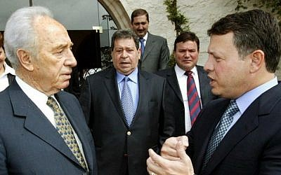 File photo provided by the Jordanian royal palace showing Jordan's King Abdullah II, right, receiving Israeli president Shimon Peres at his private residence in Amman, February 10, 2004 . (AFP/Yousef ALLAN)