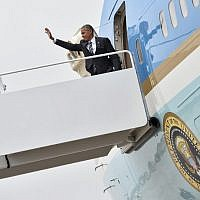 US President Barack Obama boards Air Force One at Andrews Air Force Base in Maryland on September 29, 2016 as he departs for Israel to attend the funeral of former Israeli president Shimon Peres in Jerusalem. (AFP Photo/Nicholas Kamm)