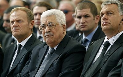 Palestinian Authority President Mahmoud Abbas, center, sits alongside European Council President Donald Tusk, left, and Romanian President Klaus Iohannis at Jerusalem's Mount Herzl national cemetery during the funeral of former Israeli president Shimon Peres on September 30, 2016. (AFP/Pool/Abir Sultan)