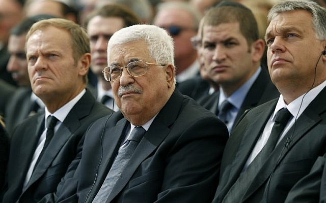 Palestinian Authority President Mahmoud Abbas (C) sits alongside European Council President Donald Tusk (L) and Romanian President Klaus Iohannis at Jerusalem's Mount Herzl national cemetery during the funeral of former Israeli president Shimon Peres on September 30, 2016. (AFP/Pool/Abir Sultan)