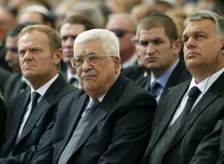 Palestinian Authority President Mahmoud Abbas (C) sits alongside European Council President Donald Tusk (L) and Hungarian President Viktor Orban at Jerusalem's Mount Herzl national cemetery during the funeral of former Israeli president Shimon Peres on September 30, 2016. (AFP/Pool/Abir Sultan)