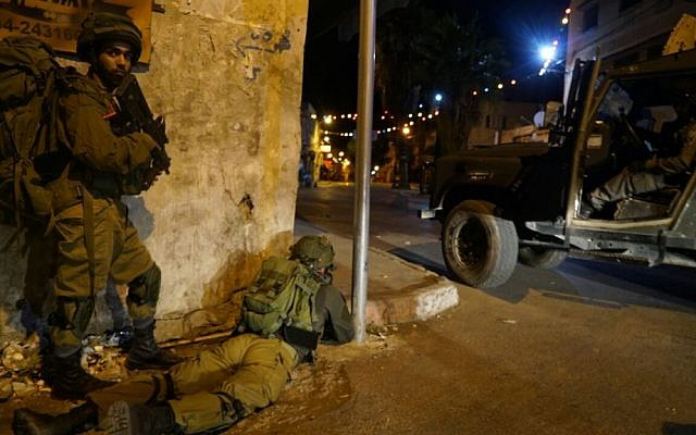 IDF soldiers during a raid on illegal weapons manufacturing workshops in the Palestinian city of Jenin in the northern West Bank on September 26, 2016. (IDF Spokesperson's Unit)