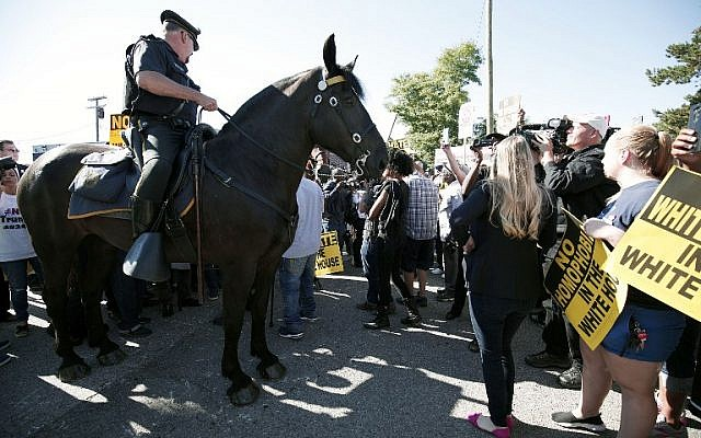 Mounted Detroit Police help control protesters as they protest Republican Presidential Nominee Donald Trump's visit to Great Faith International Ministries Church September 3, 2016 in Detroit, Michigan. (Bill Pugliano/Getty Images/AFP)