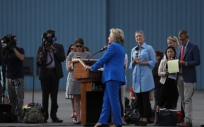 Democratic presidential nominee former Secretary of State Hillary Clinton speaks to reporters on the tarmac at Westchester County Airport on September 8, 2016 in White Plains, New York. (Justin Sullivan/Getty Images/AFP)