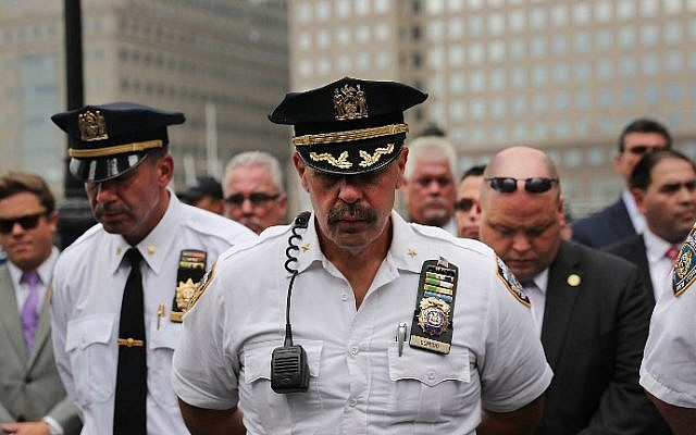 Police pause during a procession in Lower Manhattan to mark the 15th anniversary of the 9/11 attacks and the police officers who were killed during and after the event, on September 9, 2016 in New York City. (Spencer Platt/Getty Images/AFP)