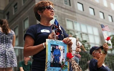 Family members of fallen officers watch a procession in Lower Manhattan to mark the 15th anniversary of the 9/11 attacks and the police officers who were killed during and after the event, on September 9, 2016 in New York City. (Spencer Platt/Getty Images/AFP)