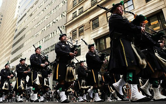 Members of the NYPD Emerald Society Pipes and Drums band march during a procession in Lower Manhattan to mark the 15th anniversary of the 9/11 attacks and the police officers who were killed during and after the event, on September 9, 2016 in New York City. (Spencer Platt/Getty Images/AFP)