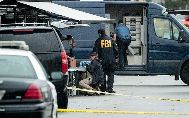 Members of the Federal Bureau of Investigation (FBI) work at the site where Ahmad Khan Rahami, who was wanted in connection to a bombing in Manhattan, was arrested after a shootout with police, Linden, New Jersey, September 19, 2016. (Drew Angerer/Getty Images/AFP)