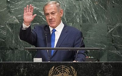 Prime Minister Benjamin Netanyahu waves to the audience after addressing the United Nations General Assembly at UN headquarters, September 22, 2016 in New York City. (Drew Angerer/Getty Images/AFP)