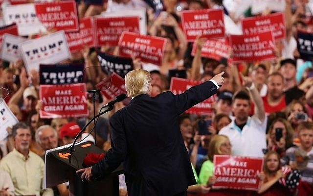 Donald Trump speaks to a large group of supporters at a Florida airport hanger the day after his first debate with Hillary Clinton on September 27, 2016 in Melbourne, Florida. (Spencer Platt/Getty Images/AFP)