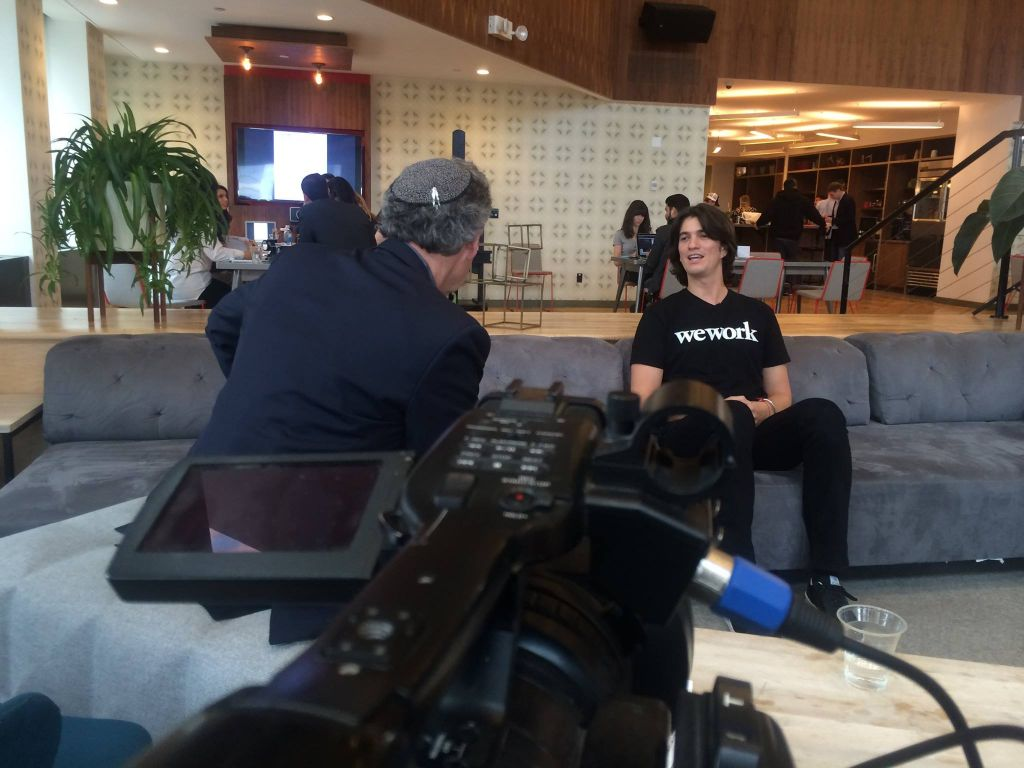 Harold Klein interviewing Adam Neumann, the founder of WeWork, for the video series. (Teletime Video)