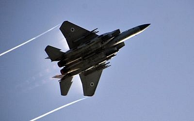 An Israel Air Force F-15 flies overhead during an exercise in the Golan Heights on February 23, 2014. (Gu Ashash/Israel Air Force/Flickr)