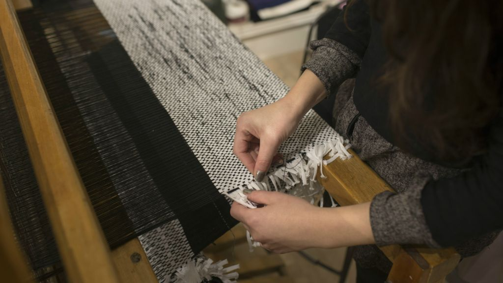 Adi Yair learned to warp and weft on a loom in an Old City prayer shawl shop (Courtesy Adi Yair)