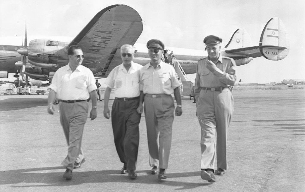 From left, then-director-general of the Defense Ministry Shimon Peres, defense minister Pinhas Lavon, IDF chief of staff Moshe Dayan and deputy IDF chief of staff Yosef Avidar on August 19, 1954. (Asaf Kutin/Bamahane/Defense Ministry Archives)