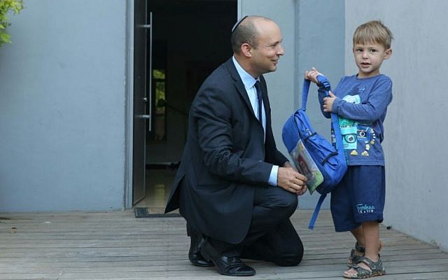 Education Minister Naftati Bennett with his son before his first day of school on September 1, 2016. (Education Ministry)