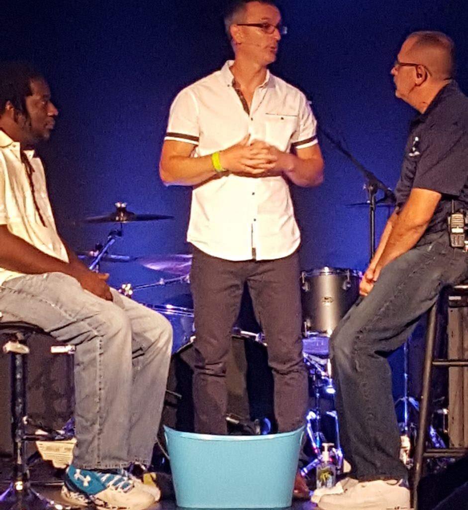 At Church Unleashed in Commack, New York, pastor Todd Bishop washed the feet of two congregants in July 2016 (Matt Lebovic/The Times of Israel)