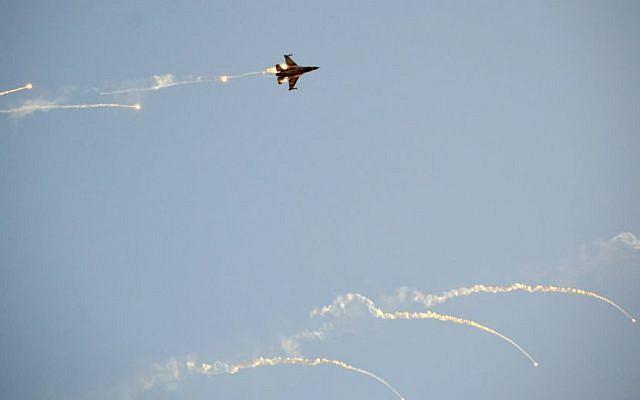 Illustrative: An Israel Air Force F-16 fighter jet fires off flares during a demonstration on December 31, 2015. (Hagar Amibar/Israel Air Force/Flickr)