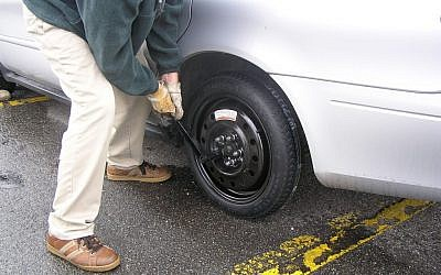 Changing a tire (CC BY robmba, Flickr)