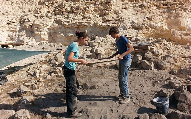 Students of the Har Ha-Negev Field School at work and sifting organic matter at the Avdat national park (Israel Antiquities Authority/Courtesy)