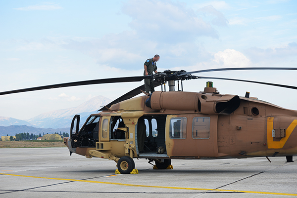 A technician works on an Israeli Air Force Blackhawk helicopter during a 16-day exercise in Greece in September 2016. (Israeli Air Force)