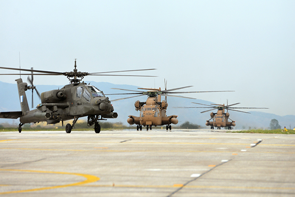 Israeli and Greek helicopters on the tarmac during a 16-day exercise in Greece in September 2016. (Israeli Air Force)