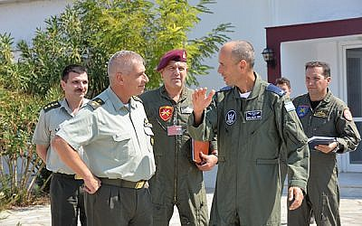 Head of the IAF helicopter and air support squadron Brig. Gen. Nir Nin-Nun, right, speaks with director of the Hellenic Army's Aerial Division Brig. Gen. Christos Iliopoylos, left, during a 16-day exercise in Greece in September 2016. (Israeli Air Force)