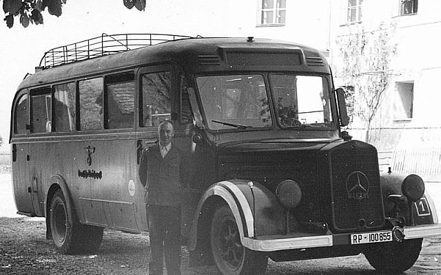 A bus and driver photographed outside Germany's Hartheim killing center in 1940, where physically and mentally disabled people were given 'mercy killings' through the secret T4 program (Public domain)