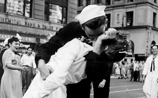 In this photo provided by the US Navy, sailor George Mendonsa and nurse Greta Zimmer Friedman kiss passionately in Manhattan's Times Square, as New York City celebrates the end of World War II, on August 14, 1945. (US Navy/Victor Jorgensen)