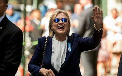 Democratic presidential candidate Hillary Clinton waves after leaving an apartment building Sunday, September 11, 2016, in New York. (AP Photo/Andrew Harnik)