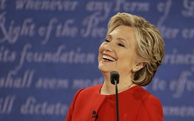 Democratic presidential nominee Hillary Clinton laughs to Republican presidential nominee Donald Trump during the presidential debate at Hofstra University in Hempstead, New York, Monday, Sept. 26, 2016. (AP Photo/Julio Cortez)
