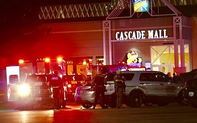 Law enforcement officers work at the crime scene outside of Cascade Mall in Burlington, Wash., where several people were fatally shot on Friday, Sept. 23, 2016. (Dean Rutz/The Seattle Times via AP)