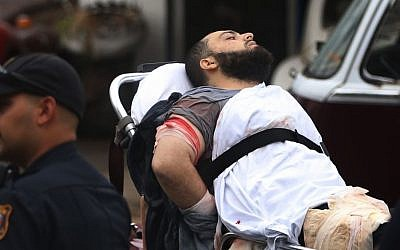 Ahmad Khan Rahami is taken into custody after a shootout with police Monday, Sept. 19, 2016, in Linden, New Jersey. (Ed Murray/NJ Advance Media via AP)