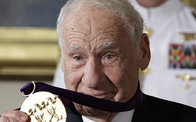 Actor, comedian and writer Mel Brooks holds up his 2015 National Medal of Arts awarded to him by President Barack Obama during a ceremony in the East Room of the White House, Thursday, Sept. 22, 2016, in Washington. (AP Photo/Carolyn Kaster)