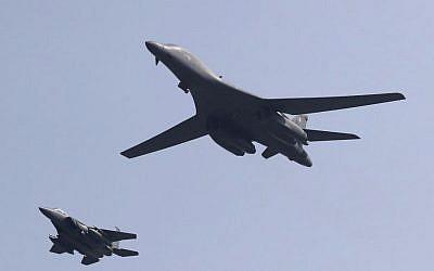 US B-1B bomber, right, flies over Osan Air Base with South Korean Air Forces jet in Pyeongtaek, South Korea, Tuesday, Sept. 13, 2016. (AP Photo/Lee Jin-man)