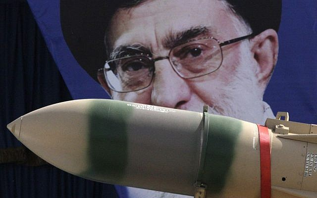 In this Thursday, April 18, 2013 photo, a Yaser missile is displayed by the Iranian army in front of a portrait of supreme leader Ayatollah Ali Khamenei during a parade marking National Army Day at the mausoleum of the late revolutionary founder Ayatollah Khomeini just outside Tehran, Iran. (AP Photo/Vahid Salemi, File)