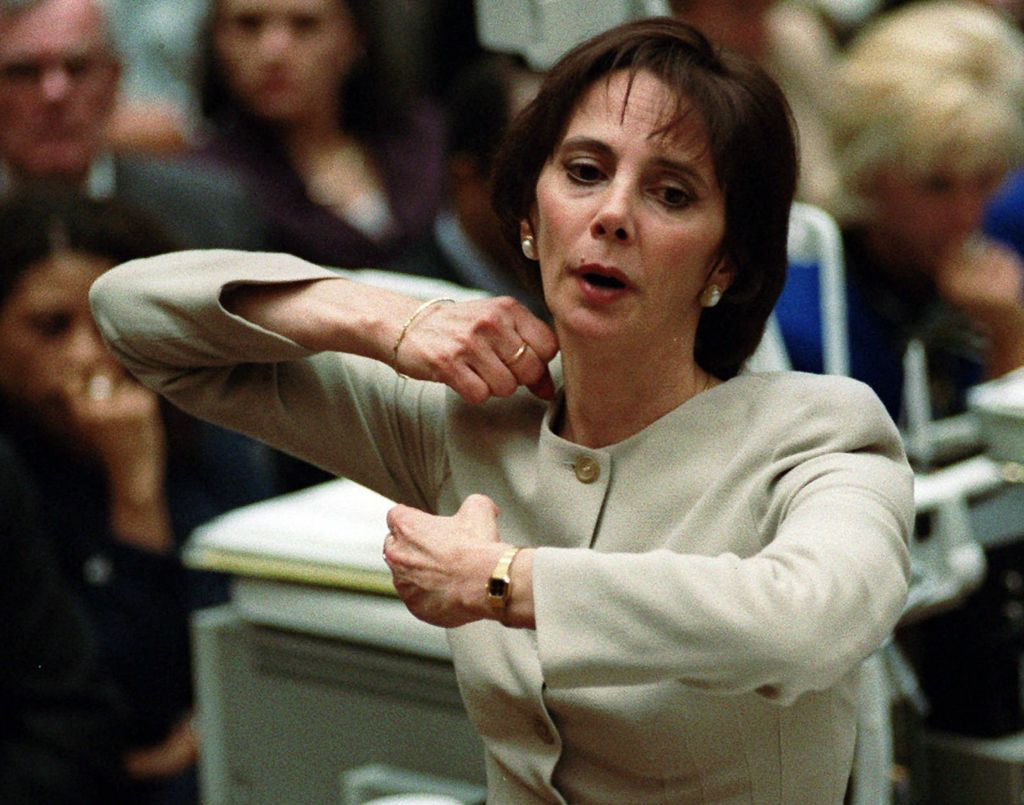 In this Sept. 26, 1995 file photo, prosecutor Marcia Clark demonstrates to the jury how the murders of Nicole Brown Simpson and Ron Goldman were committed during her closing arguments in the O.J. Simpson double-murder trial in Los Angeles. (AP Photo/Myung J. Chun, Pool, File)
