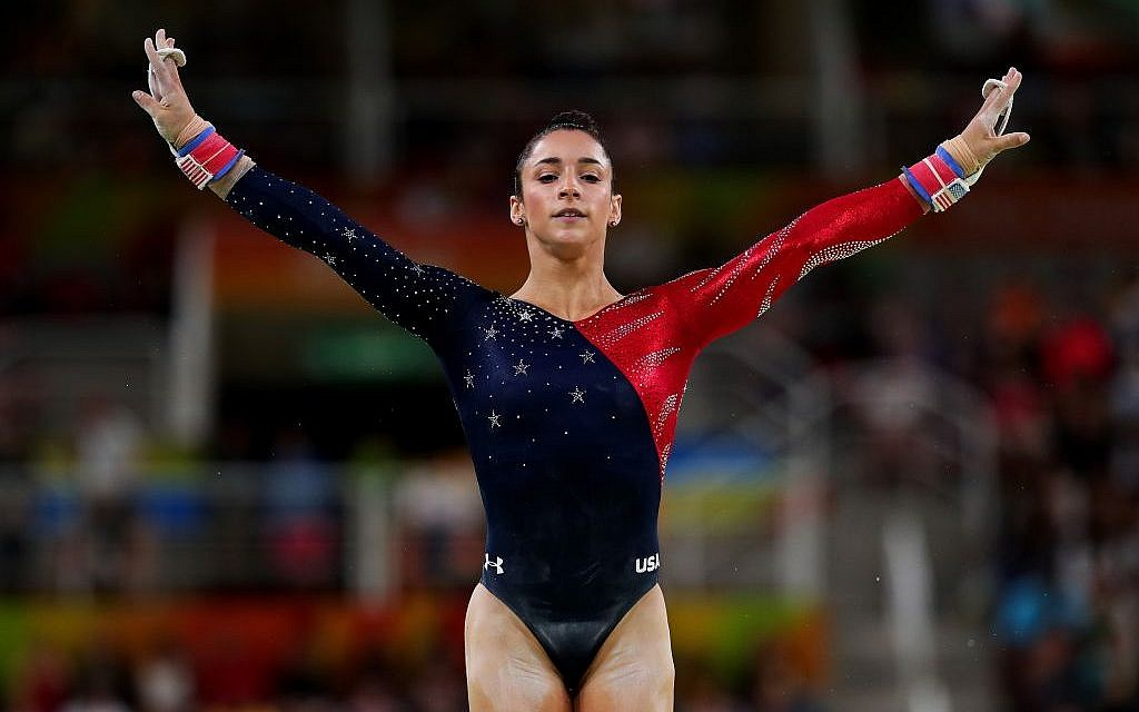 Aly Raisman competing on the uneven bars at the Rio Olympic Games, August 7, 2016. (Tom Pennington/Getty Images/JTA)