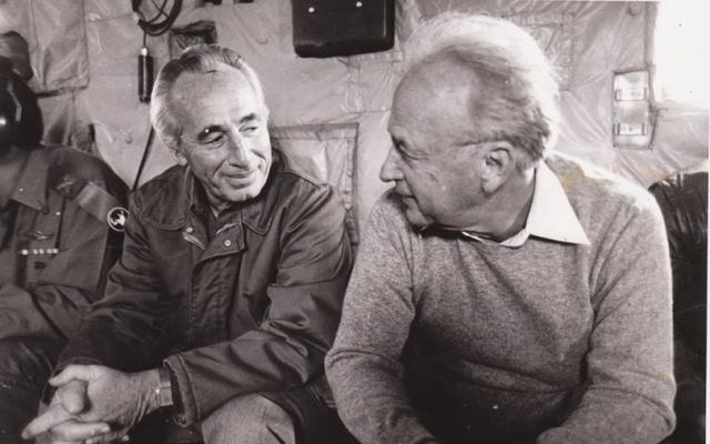 Then-defense minister Shimon Peres (left) with Yitzhak Rabin. (GPO)