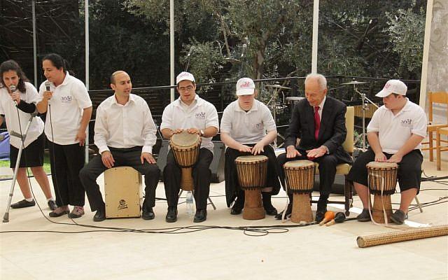 President Shimon Peres hosting children with disabilities in his presidential sukkah (Yosef Avi Yair Engel)