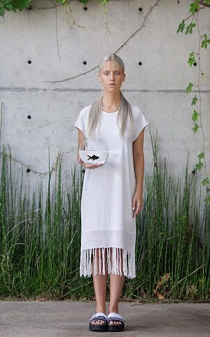 An all-white, handwoven white shift for the upcoming high holidays, made by Jerusalem artist Adi Yair (Courtesy Adi Yair)