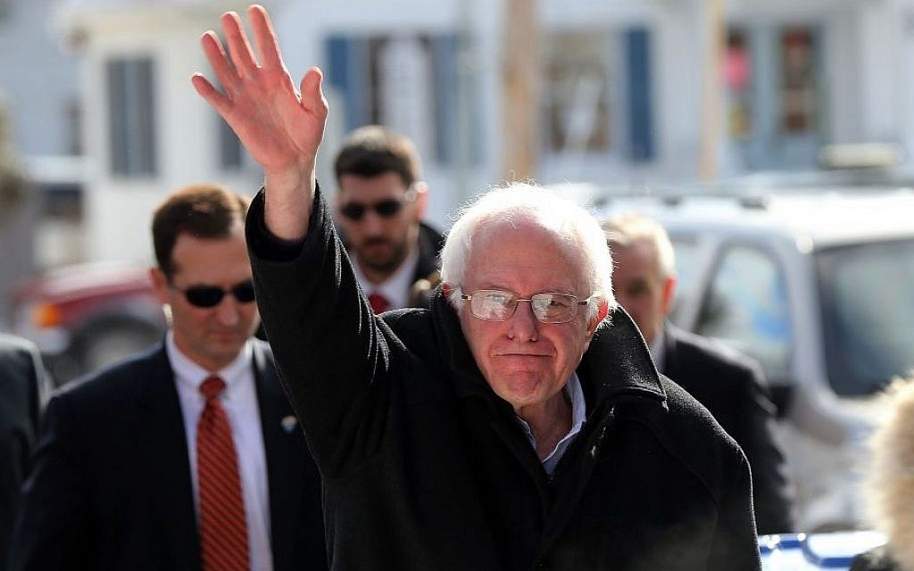 Sen. Bernie Sanders waving in Concord on the day of the Democratic primary in New Hampshire,  February 9, 2016. (Spencer Platt/Getty Images/JTA)