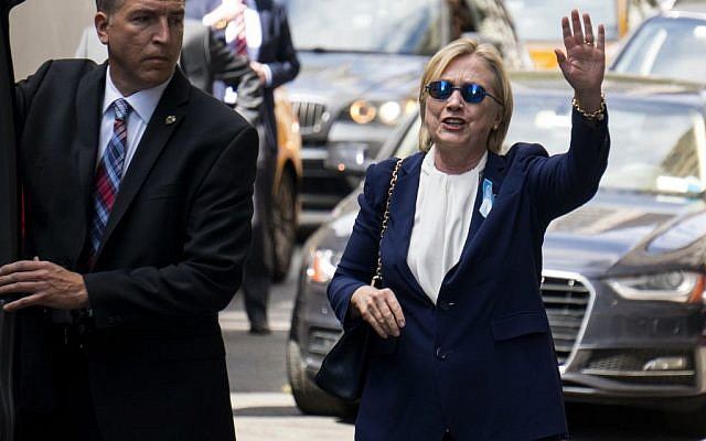 Democratic presidential candidate Hillary Clinton walks from her daughter's apartment building Sunday, Sept. 11, 2016, in New York. Clinton unexpectedly left Sunday's 9/11 anniversary ceremony in New York and is suffering from pneumonia according to her doctor. (AP Photo/Craig Ruttle)