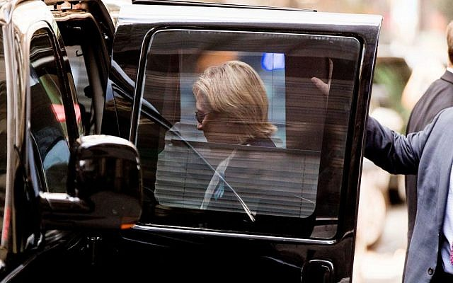 """Democratic presidential candidate Hillary Clinton gets into a van as she leaves an apartment building Sunday, Sept. 11, 2016, in New York. Clinton's campaign said the Democratic presidential nominee left the 9/11 anniversary ceremony in New York early after feeling """"overheated."""" (AP Photo/Andrew Harnik)"""