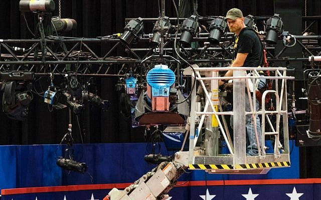 A technician examines the lighting grid as preparations continue for Monday's first presidential debate between Democrat Hillary Clinton and Republican Donald Trump, Saturday, Sept. 24, 2016, at Hofstra University in Hempstead, New York. (AP Photo/J. David Ake)