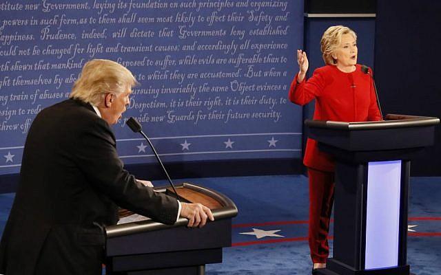 Republican presidential nominee Donald Trump and Democratic presidential nominee Hillary Clinton speak at the same time during the presidential debate at Hofstra University in Hempstead, New York, September 26, 2016. (Rick T. Wilking/Pool via AP)