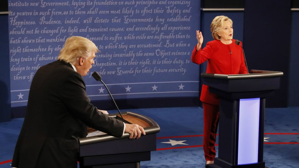 Republican presidential nominee Donald Trump and Democratic presidential nominee Hillary Clinton speak at the same time during the presidential debate at Hofstra University in Hempstead, New York, Monday, Sept. 26, 2016. (Rick T. Wilking/Pool via AP)